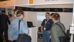 Wojtek Wisniewski at RCS Poland booth with RCS customers.